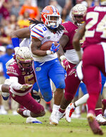 Florida running back Jordan Scarlett (25) runs against Florida State in the second half of an NCAA college football game in Tallahassee, Fla., Saturday, Nov. 24, 2018. Florida defeated Florida State 41-14. (AP Photo/Mark Wallheiser)