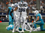 Dallas Cowboys defensive end Christian Covington (95) and Maliek Collins (96) celebrate a sack of Miami Dolphins quarterback Josh Rosen (3) in the second half of an NFL football game in Arlington, Texas, Sunday, Sept. 22, 2019. (AP Photo/Ron Jenkins)