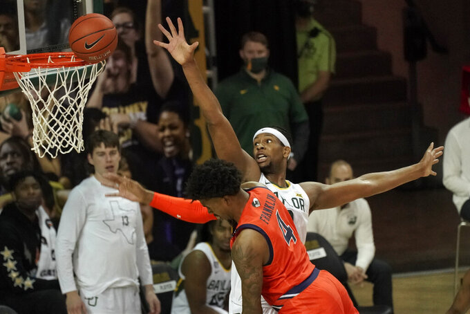 Auburn's Javon Franklin (4) runs into Baylor's Flo Thamba (0) as he shoots during the first half of an NCAA college basketball game in Waco, Texas, Saturday, Jan. 30, 2021. (AP Photo/Chuck Burton)