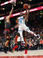 Charlotte Hornets guard Kemba Walker (15) scores as Atlanta Hawks guard Trae Young (11) defends during the second half of an NBA basketball Saturday, Feb. 9, 2019, in Atlanta. Charlotte won 129-120. (AP Photo/John Bazemore)