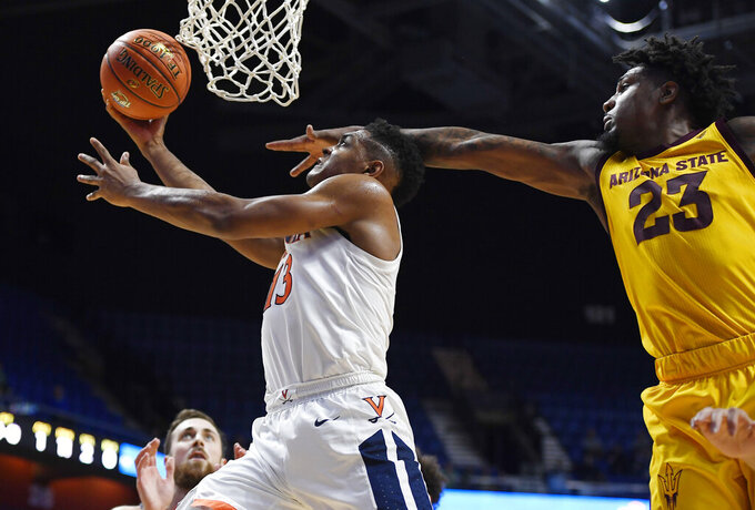 Virginia's Casey Morsell, left, makes a basket as Arizona State's Romello White defends during the first half of an NCAA college basketball game, Sunday, Nov. 24, 2019, in Uncasville, Conn. (AP Photo/Jessica Hill)