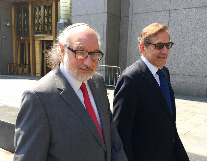 FILE - In this July 22, 2016, file photo convicted spy Jonathan Pollard, left, with his lawyer, Eliot Lauer, leaves federal court in New York following a hearing, Pollard, the former Navy intelligence analyst who served 30 years in prison for selling secrets to Israel, has completed his parole, the Justice Department said Friday, Nov. 20, 2020. (AP Photo/Larry Neumeister, File)
