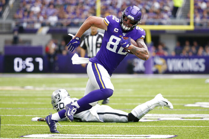 FILE - In this Sept. 22, 2019, file photo, Minnesota Vikings tight end Kyle Rudolph (82) runs from Oakland Raiders cornerback Daryl Worley (20) after making a reception during the first half of an NFL football game in Minneapolis. The Vikings have released two-time Pro Bowl tight end Rudolph. This ends his 10-season run with the team. The move creates a little more than $5 million in salary cap space. (AP Photo/Bruce Kluckhohn, File)