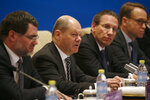 German Finance Minister Olaf Scholz, second from left, speaks during the China-Germany High Level Financial Dialogue with Chinese Vice Premier Liu He at the Diaoyutai State Guesthouse in Beijing, Friday, Jan. 18, 2019. (AP Photo/Andy Wong, Pool)
