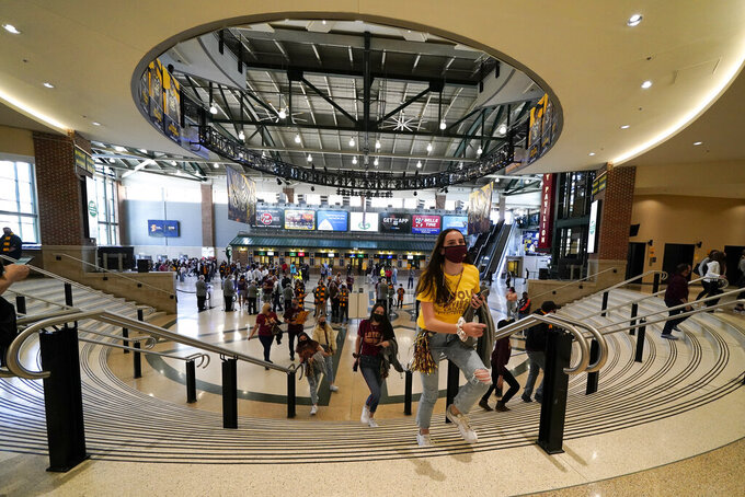 Fans arrive at Bankers Life Fieldhouse before a Sweet 16 game between Loyola Chicago and Oregon State in the NCAA men's college basketball tournament at Bankers Life Fieldhouse, Saturday, March 27, 2021, in Indianapolis. (AP Photo/Darron Cummings)