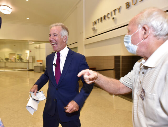 Congressman Richard Neal, left, celebrates his victory in the Democratic primary over challenger, Holyoke Mayor Alex Morse, Tuesday, Sept. 1, 2020, in Springfield, Mass. (Don Treeger/The Republican via AP)