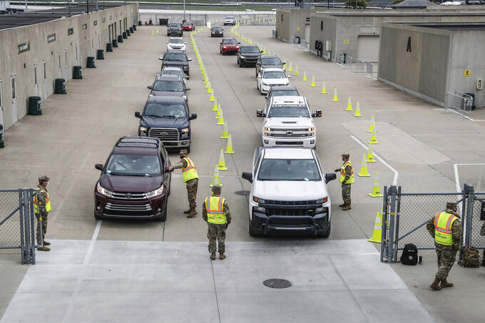 People drive up for the Johnson & Johnson COVID-19 vaccination on Saturday, April 24, 2021, at The Indianapolis Motor Speedway  in Indianapolis.  With a green light from federal health officials, several states resumed use of the one-shot Johnson & Johnson coronavirus vaccine on Saturday. Among the venues where it's being deployed is the Indianapolis Motor Speedway, where free vaccinations were available to anyone 18 or older. (Michelle Pemberton/The Indianapolis Star via AP)