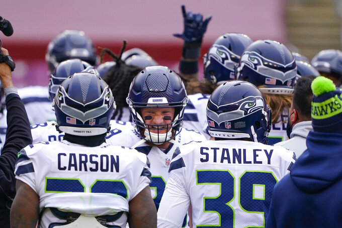Seattle Seahawks tight end Will Dissly (89) in the center of a team huddle before the start of an NFL football game against the Washington Football Team, Sunday, Dec. 20, 2020, in Landover, Md. (AP Photo/Mark Tenally)