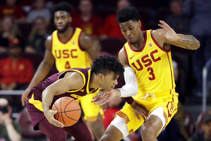 Arizona State guard Remy Martin, left, is defended by Southern California guard Elijah Weaver (3) during the first half of an NCAA college basketball game Saturday, Feb. 29, 2020, in Los Angeles. (AP Photo/Marcio Jose Sanchez)