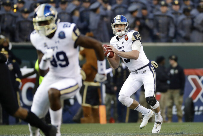 Navy's Zach Abey looks to pass during the first half of an NCAA college football game against Army, Saturday, Dec. 8, 2018, in Philadelphia. (AP Photo/Matt Slocum)