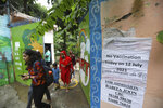 People who came to get inoculated agains the coronavirus return following non availability of vaccine in New Delhi, India, Tuesday, July 13, 2021. (AP Photo/Manish Swarup)