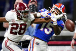 Alabama defensive back Josh Jobe (28) breaks up a pass intended for Florida wide receiver Jacob Copeland (15) during the second half of the Southeastern Conference championship NCAA college football game, Saturday, Dec. 19, 2020, in Atlanta. (AP Photo/Brynn Anderson)