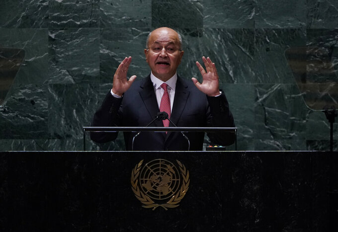 Barham Salih, President of Iraq addresses the 76th Session of the U.N. General Assembly at United Nations headquarters in New York, on Thursday, Sept. 23, 2021. (Timothy A. Clary/Pool Photo via AP)