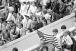 FILE - In this July 19, 1980, file photo, an unidentified youth displays the flag of the United States during opening ceremonies at the Summer Olympic Games in Moscow, The United State did not attend the Olympics in Moscow but rather led a boycott in protest of Soviet intervention in Afghanistan. (AP Photo/File)