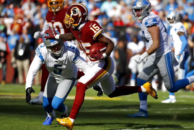 Detroit Lions kicker Matt Prater (5) makes a hit on Washington Redskins' Steven Sims (15) while he returns his opening kickoff during the first half of an NFL football game, Sunday, Nov. 24, 2019, in Landover, Md. (AP Photo/Patrick Semansky)