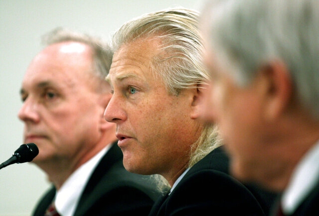 FILE - In this Feb. 26, 2008, file photo, Bumble Bee Foods President and Chief Executive Officer Christopher Lischewski, center, flanked by Butterball President and Chief Executive Officer Keith Shoemaker, left, and Dole Food Company President and Chief Executive Officer David DeLorenzo, testifies on Capitol Hill in Washington. The former CEO of Bumble Bee Foods has been convicted for his part in a canned tuna price-fixing conspiracy involving the industry's top three companies. The Department of Justice says a jury found Lischewski guilty on Tuesday, Dec. 3, 2019. (AP Photo/Lauren Victoria Burke, File)