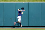 Milwaukee Brewers center fielder Avisail Garcia runs to catch a fly ball by St. Louis Cardinals' Paul DeJong during the second inning of a baseball game Sunday, Sept. 27, 2020, in St. Louis. (AP Photo/Jeff Roberson)