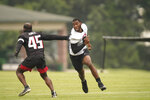 Atlanta Falcons tight end Kyle Pitts (8) runs drills with linebacker Deion Jones (45) during NFL football practice on Friday, July 30, 2021, in Flowery Branch, Ga. (AP Photo/Brynn Anderson)