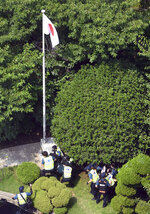 CORRECTS DATE - South Korean police officers detain protesters at backyard of Japanese consulate in Busan, South Korea, Monday, July 22, 2019. South Korean police say they've detained six people for allegedly illegally entering a Japanese diplomatic facility in South Korea. (Huh Kyung-min/Newsis via AP)