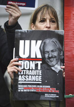 A supporter of Wikileaks founder Julian Assange demonstrates oustide Westminster Magistrates' Court in London where Assange is expected to appear as he fights extradition to the United States on charges of conspiring to hack into a Pentagon computer, in London, Monday, Oct, 21, 2019. U.S. authorities accuse Assange of scheming with former Army intelligence analyst Chelsea Manning to break a password for a classified government computer. (Kirsty O'Connor/PA via AP)