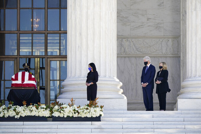 Former President Bill Clinton, second from right, and former Secretary of State Hillary Clinton pay respects as Justice Ruth Bader Ginsburg lies in repose under the Portico at the top of the front steps of the U.S. Supreme Court building on Wednesday, Sept. 23, 2020, in Washington. Ginsburg, 87, died of cancer on Sept. 18. (AP Photo/J. Scott Applewhite)
