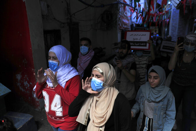 Protesters shout slogans in support of Palestinians in the latest round of violence, in Beirut, Lebanon, Tuesday, May 11, 2021. A confrontation between Israel and Hamas sparked by weeks of tensions in contested Jerusalem escalated Tuesday. (AP Photo/Hussein Malla)