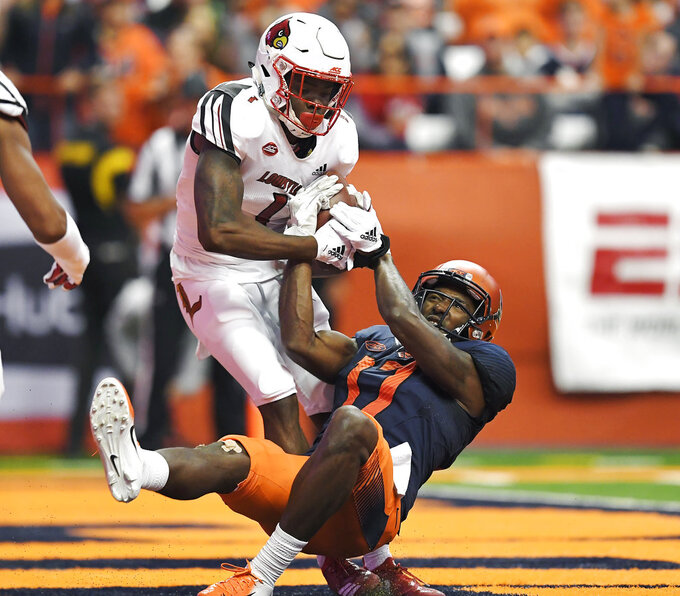 Louisville cornerback P.J. Mbanasor, left, intercepts a pass in the end zone intended for Syracuse wide receiver Jamal Custis during the second half of an NCAA college football game in Syracuse, N.Y., Friday, Nov. 9, 2018. (AP Photo/Adrian Kraus)