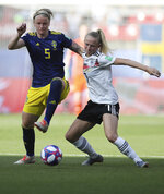 Sweden's Nilla Fischer, left, challenges for the ball with Germany's Lea Schueller during the of the Women's World Cup quarterfinal soccer match between Germany and Sweden at Roazhon Park in Rennes, France, Saturday, June 29, 2019. (AP Photo/David Vincent)