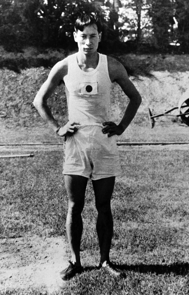 FILE - In this Aug. 2, 1928, file photo, Mikio Oda, of Japan, poses after he had won the gold medal in the men's Triple Jump at the Olympic Games in Amsterdam. (AP Photo/File)