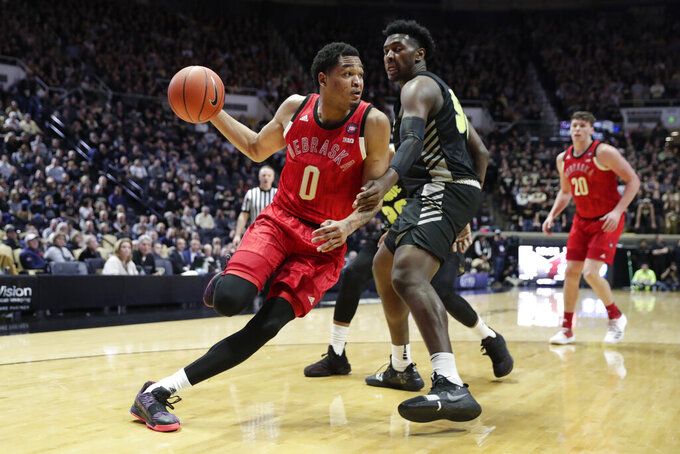 Nebraska guard James Palmer Jr. (0) drives past Purdue forward Trevion Williams (50) during the second half of an NCAA college basketball game in West Lafayette, Ind., Saturday, Feb. 9, 2019. (AP Photo/Michael Conroy)
