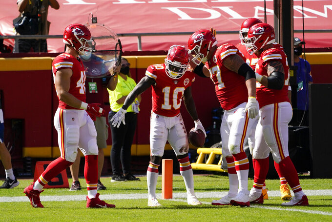 Kansas City Chiefs wide receiver Tyreek Hill (10) celebrates with teammates after scoring on a 10-yard touchdown run during the first half of an NFL football game against the Las Vegas Raiders, Sunday, Oct. 11, 2020, in Kansas City. (AP Photo/Jeff Roberson)