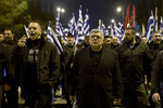 In this Monday, March 5, 2018, file photo Golden Dawn lawmaker Ilias Kasidiaris, left, shouts slogans next to Golden Dawn party leader Nikos Mihaloliakos during protest in central Athens.Golden Dawn, the far-right, anti-immigrant party that had shocked Greek politics by evolving from a marginal, violent neo-Nazi group into Greece's third-largest party during the country's economic crisis, was knocked out of Parliament in Sunday's national election. (AP Photo/Petros Giannakouris, file)