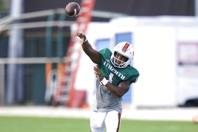 Miami starting quarterback D'Eriq King does drills during NCAA college football practice, Tuesday, Aug. 31, 2021, in Coral Gables, Fla.(AP Photo/Lynne Sladky)