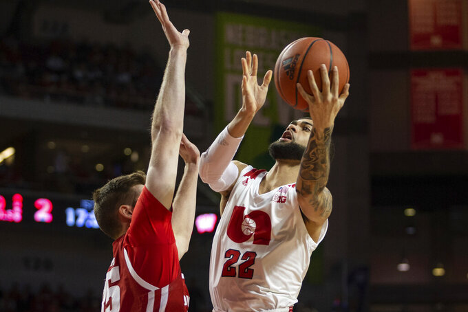 Nebraska guard Haanif Cheatham (22) makes a lay up against Wisconsin forward Nate Reuvers (35) during the first half of an NCAA college basketball game in Lincoln, Neb., Saturday, Feb. 15, 2020. (AP Photo/John Peterson)