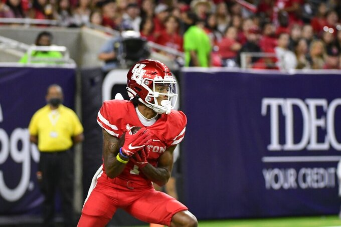 Houston wide receiver Nathaniel Dell (1) returns a kick against Texas Tech during the second half of an NCAA college football game Saturday, Sept. 4, 2021, in Houston. (AP Photo/Justin Rex)