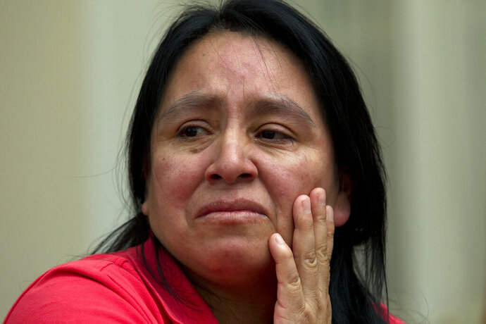Maria Chavalan-Sut of Guatemala speaks during an interview at the Wesley Memorial United Methodist Church in Charlottesville, Va., on Wednesday, July 17, 2019. Chavalan-Sut is among a number of immigrants taking sanctuary at houses of worship who have received letters from immigration authorities threatening them with huge fines under the latest tactic from the Trump administration. (AP Photo/Jose Luis Magana)