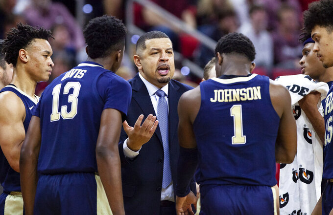 Pittsburgh coach Jeff Capel speaks to his team during a timeout in the second half of an NCAA college basketball game against North Carolina State in Raleigh, N.C., Saturday, Jan. 12, 2019. (AP Photo/Ben McKeown)