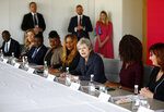 Britain's Prime Minister Theresa May attends a roundtable meeting with business leaders whose companies are inaugural signatories of the Race at Work Charter at the Southbank Centre in London, Thursday Oct. 11, 2018. (Henry Nicholls/Pool via AP)