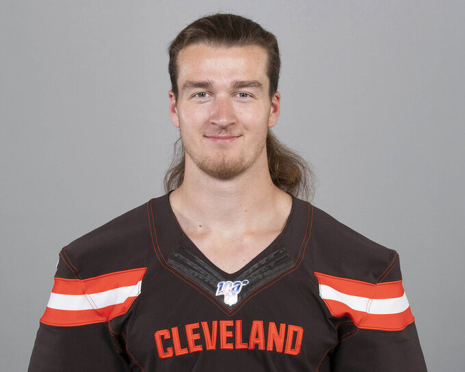 "File-This May 2, 2019 photo  shows of Jamie Gillan of the Cleveland Browns NFL football team. A Browns undrafted rookie punter, Gillan, nicknamed ""The Scottish Hammer,"" has beaten out veteran Britton Colquitt. Gillan won the starting job with solid performances in the past two preseason games, but it's still surprising the Browns would take him over Colquitt, who was a Pro Bowl alternate last season and has spent nine seasons in the NFL. He won a Super Bowl ring with Denver.  (AP Photo, File)"