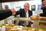 Britain's Prime Minister Boris Johnson visit a bakery during a General Election campaign trail stop in Wells, England, Thursday, Nov. 14, 2019. Britain goes to the polls on Dec. 12. (AP Photo/Frank Augstein, Pool)
