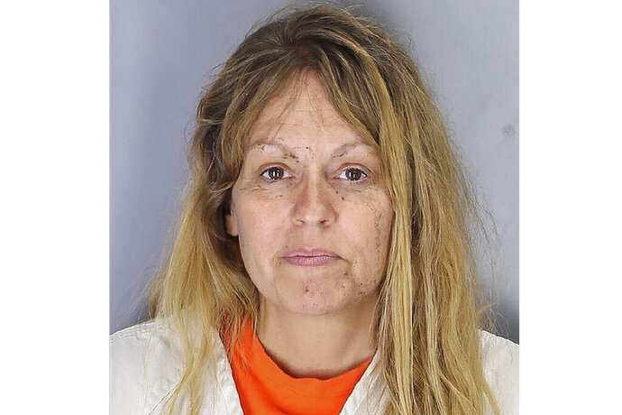 FILE - This June 29, 2019, police booking file photo provided by the Tulare County Sheriff's Department shows Sherri Renee Telnas. On Tuesday, July 2, 2019, Telnas, a woman accused of drowning her 12-year-old son in a California irrigation ditch 11 years after she tried to drown him in a Montana river, has been charged with murder. (Tulare County Sheriff's Office via AP, File)