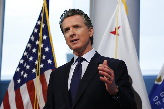 FILE - In this March 30, 2020, file photo, Gov. Gavin Newsom speaks at the Governor's Office of Emergency Services in Rancho Cordova, Calif. Gov. Newsom says the state is exploring ways to help people living in the country illegally who are not eligible for federal economic stimulus benefits. Newsom said Tuesday, April 7, 2020, he plans to unveil his plan next month. He said it is part of a broader package of economic stimulus strategies at a state level that are separate from federal benefits. (AP Photo/Rich Pedroncelli, File)