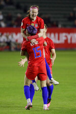 U.S. midfielder Rose Lavelle, top, celebrates with forward Megan Rapinoe after scoring against Mexico during the first half of a CONCACAF women's Olympic qualifying soccer match Friday, Feb. 7, 2020, in Carson, Calif. (AP Photo/Chris Carlson)