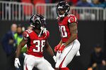 Atlanta Falcons running back Qadree Ollison (30) celebrates his touchdown with Atlanta Falcons running back Kenjon Barner (38) during the second half of an NFL football game against the Jacksonville Jaguars, Sunday, Dec. 22, 2019, in Atlanta. (AP Photo/John Amis)