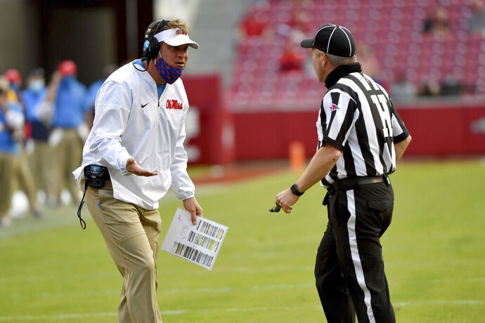 Mississippi coach Lane Kiffin reacts to a call during the second half of an NCAA college football game against Arkansas, Saturday, Oct. 17, 2020, in Fayetteville, Ark. (AP Photo/Michael Woods)