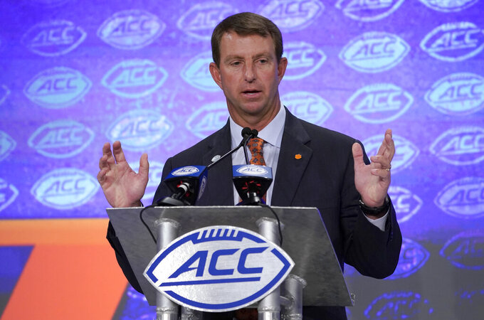 Clemson head coach Dabo Swinney speaks during the Atlantic Coast Conference NCAA college football media day in Charlotte, N.C., Wednesday, July 17, 2019. (AP Photo/Chuck Burton)