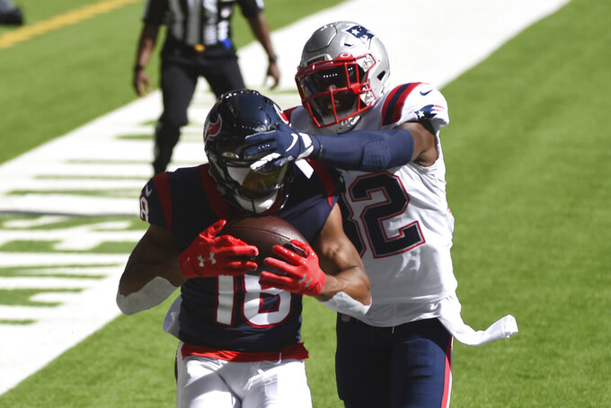 Houston Texans wide receiver Randall Cobb (18) catches a pass for a touchdown in front of New England Patriots free safety Devin McCourty (32) during the first half of an NFL football game, Sunday, Nov. 22, 2020, in Houston. (AP Photo/Eric Christian Smith)