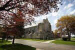 In this May 6, 2019, photo, the exterior of Assumption of the Blessed Virgin March Parish is framed by trees in Detroit. The Roman Catholic Archdiocese of Detroit said Sunday, July 7 that it has removed Perrone from public ministry after receiving what it described as a