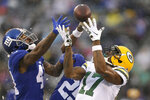 New York Giants' Antoine Bethea, left breaks up a pass intended for Green Bay Packers' Davante Adams during the first half of an NFL football game, Sunday, Dec. 1, 2019, in East Rutherford, N.J. (AP Photo/Adam Hunger)