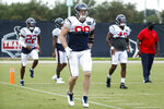 Houston Texans defensive end J.J. Watt (99) warms up during an NFL training camp football practice Monday, Aug. 24, 2020, in Houston. (Brett Coomer/Houston Chronicle via AP, Pool)